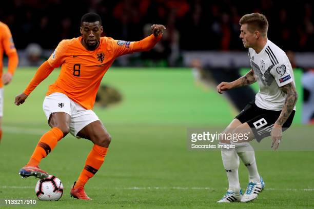 Georginio Wijnaldum of Holland Toni Kroos of Germany during the EURO Qualifier match between Holland v Germany at the Johan Cruijff Arena on March 24...