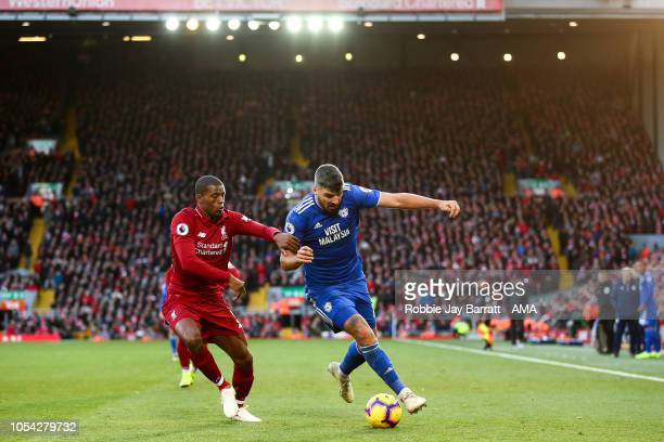 Georginio Wijnaldum of Liverpool and Callum Paterson of Cardiff City during the Premier League match between Liverpool FC and Cardiff City at Anfield...