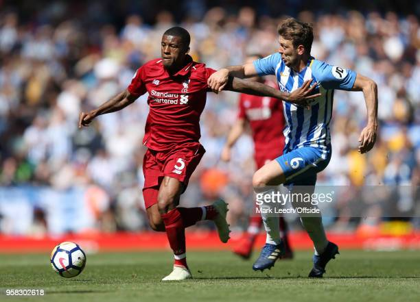 Georginio Wijnaldum of Liverpool and Dale Stephens of Brighton during the Premier League match between Liverpool and Brighton and Hove Albion at...