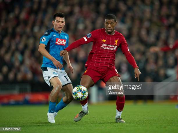 Georginio Wijnaldum of Liverpool and Hirving Lozano of SSC Napoli in action during the UEFA Champions League group E match between Liverpool FC and...