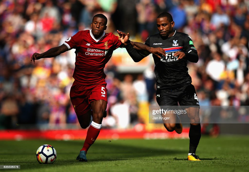 Georginio Wijnaldum of Liverpool and Jason Puncheon of Crystal Palace battle for possession during the Premier League match between Liverpool and Crystal Palace at Anfield on August 19, 2017 in Liverpool, England.