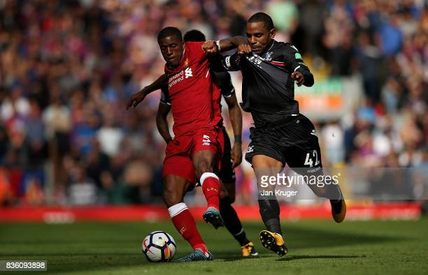 Georginio Wijnaldum of Liverpool and Jason Puncheon of Crystal Palace battle for possession during the Premier League match between Liverpool and...