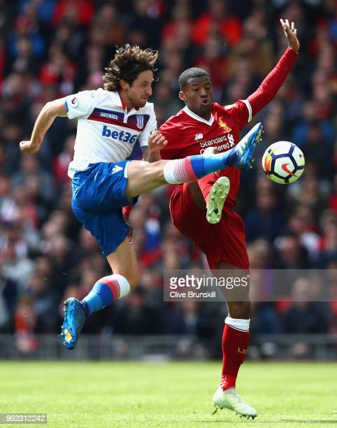 Georginio Wijnaldum of Liverpool and Joe Allen of Stoke City clash during the Premier League match between Liverpool and Stoke City at Anfield on...