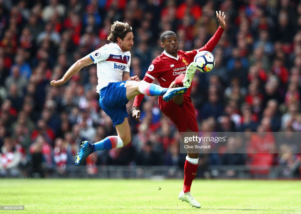 Georginio Wijnaldum of Liverpool and Joe Allen of Stoke City clash during the Premier League match between Liverpool and Stoke City at Anfield on April 28, 2018 in Liverpool, England.