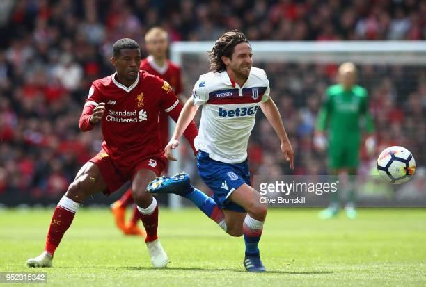 Georginio Wijnaldum of Liverpool and Joe Allen of Stoke City clash during the Premier League match between Liverpool and Stoke City at Anfield on...