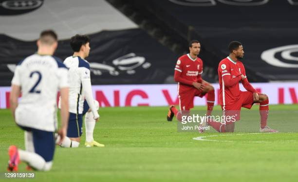 Georginio Wijnaldum of Liverpool and Joel Matip of Liverpool Takes to the knee Before the Premier League match between Tottenham Hotspur and...