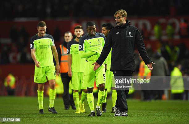 Georginio Wijnaldum of Liverpool and Jurgen Klopp manager of Liverpool in discussion after the Premier League match between Manchester United and...