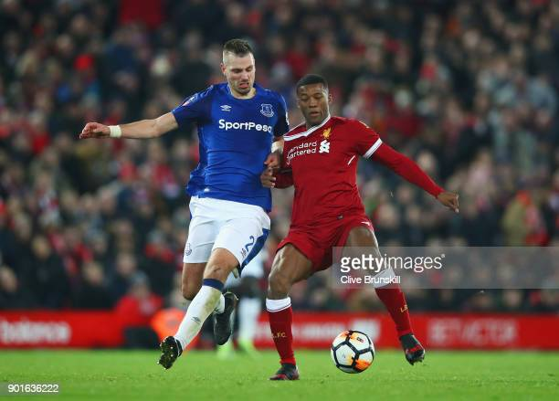 Georginio Wijnaldum of Liverpool and Morgan Schneiderlin of Everton battle for the ball during the Emirates FA Cup Third Round match between...