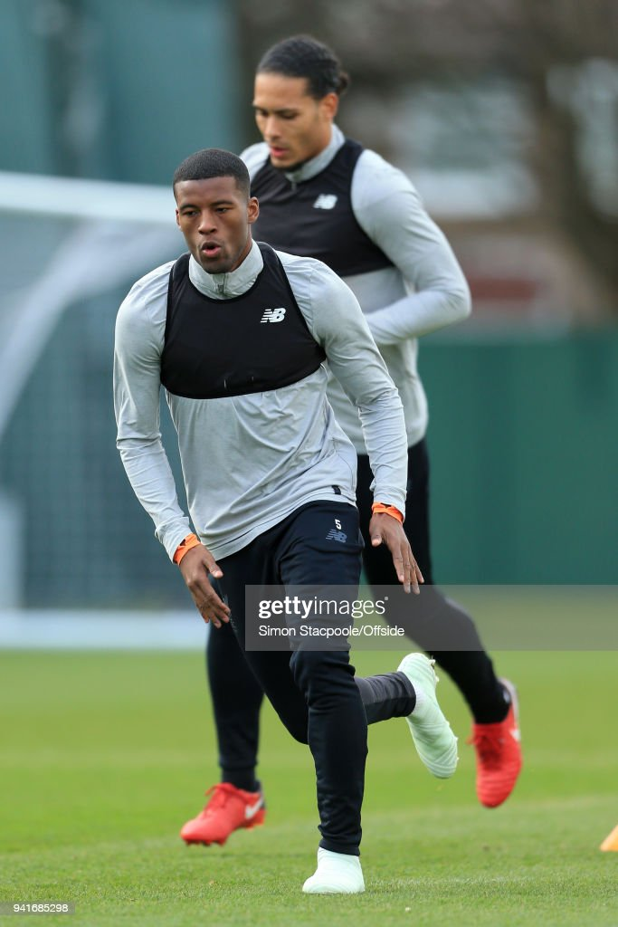 Georginio Wijnaldum of Liverpool (L) and Virgil van Dijk of Liverpool in action during a training session prior to their UEFA Champions League Quarter Final First Leg match against Manchester City at their Melwood Training Ground on April 3, 2018 in Liverpool, England.
