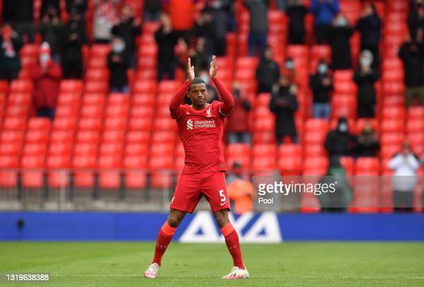 Georginio Wijnaldum of Liverpool applauds the fans as he is substituted during the Premier League match between Liverpool and Crystal Palace at...
