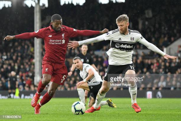 Georginio Wijnaldum of Liverpool battles for possession with Tim Ream of Fulham during the Premier League match between Fulham FC and Liverpool FC at...