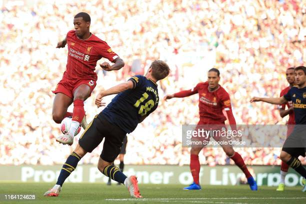 Georginio Wijnaldum of Liverpool battles with Nacho Monreal of Arsenal during the Premier League match between Liverpool and Arsenal at Anfield on...