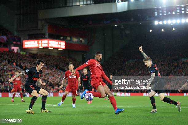 Georginio Wijnaldum of Liverpool battles with Stefan Savic of Atletico and Kieran Trippier of Atletico during the UEFA Champions League round of 16...