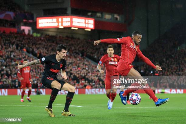 Georginio Wijnaldum of Liverpool battles with Stefan Savic of Atletico during the UEFA Champions League round of 16 second leg match between...