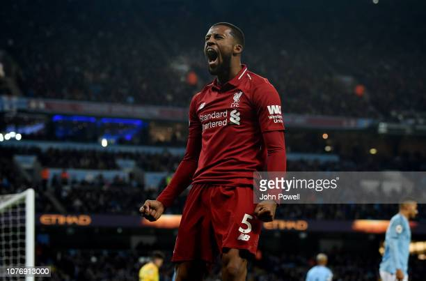 Georginio Wijnaldum of Liverpool celebrates after Roberto Firmino scores a goal during the Premier League match between Manchester City and Liverpool...