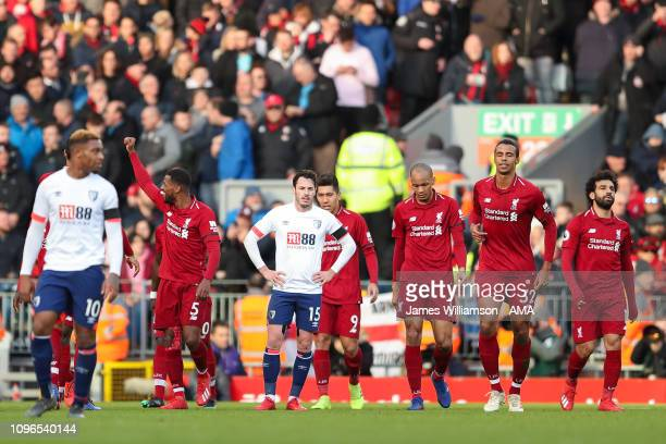 Georginio Wijnaldum of Liverpool celebrates after scoring a goal to make it 20 while a dejected Adam Smith of Bournemouth looks on during the Premier...