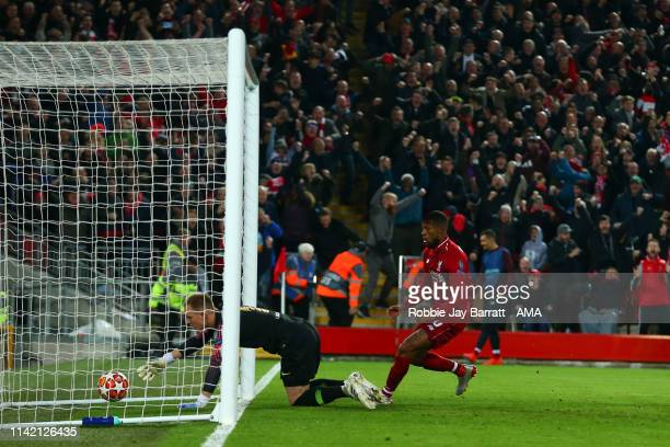 Georginio Wijnaldum of Liverpool celebrates after scoring a goal to make it 20 during the UEFA Champions League Semi Final second leg match between...