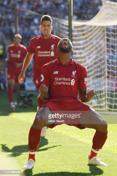 Georginio Wijnaldum of Liverpool celebrates after scoring during the Premier League match between Cardiff City and Liverpool FC at Cardiff City...