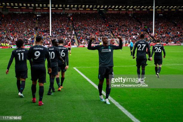 Georginio Wijnaldum of Liverpool celebrates after scoring his side's first goal to make the score 01 during the Premier League match between...