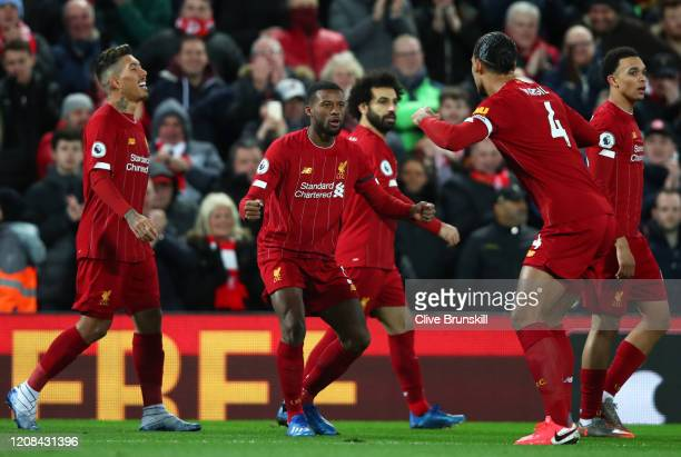 Georginio Wijnaldum of Liverpool celebrates after scoring his sides first goal during the Premier League match between Liverpool FC and West Ham...
