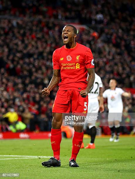 Georginio Wijnaldum of Liverpool celebrates after scoring his sides sixth goal during the Premier League match between Liverpool and Watford at...