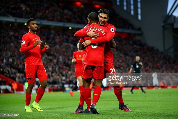 Georginio Wijnaldum of Liverpool celebrates after scoring his sides sixth goal with Emre Can during the Premier League match between Liverpool and...
