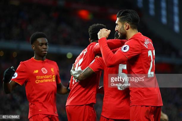 Georginio Wijnaldum of Liverpool celebrates after scoring his sides sixth goal with Emre Can and Daniel Sturridge during the Premier League match...