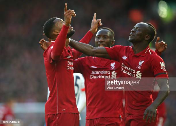 Georginio Wijnaldum of Liverpool celebrates after scoring his team's second goal with teammates Sadio Mane and Naby Keita during the Premier League...