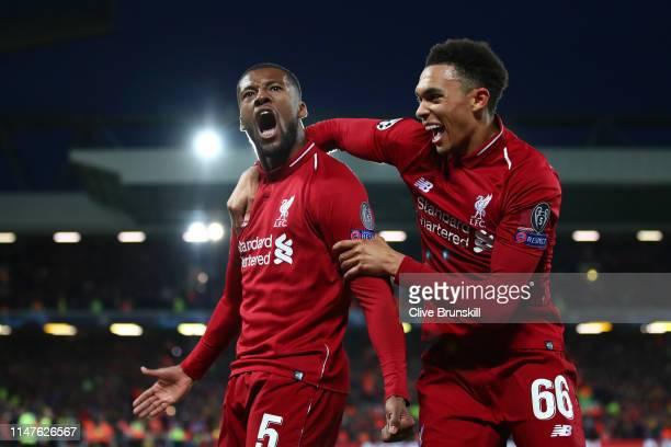 Georginio Wijnaldum of Liverpool celebrates after scoring his team's third goal with Trent Alexander-Arnold during the UEFA Champions League Semi...