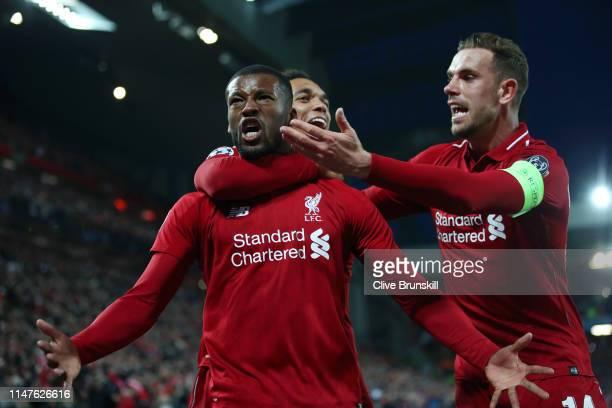 Georginio Wijnaldum of Liverpool celebrates after scoring his team's third goal with Jordan Henderson and Trent AlexanderArnold during the UEFA...