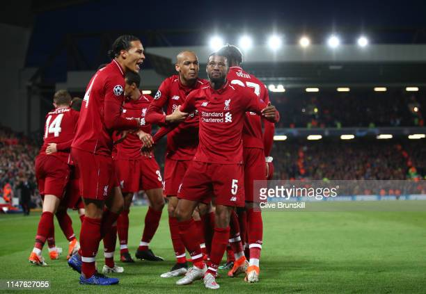 Georginio Wijnaldum of Liverpool celebrates after scoring his team's third goal with team mates during the UEFA Champions League Semi Final second...