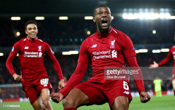Georginio Wijnaldum of Liverpool celebrates after scoring his team's third goal with Jordan Henderson and Trent AlexanderArnold during the UEFA...