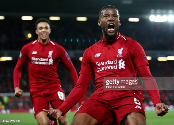 Georginio Wijnaldum of Liverpool celebrates after scoring his team's third goal with Trent AlexanderArnold during the UEFA Champions League Semi...