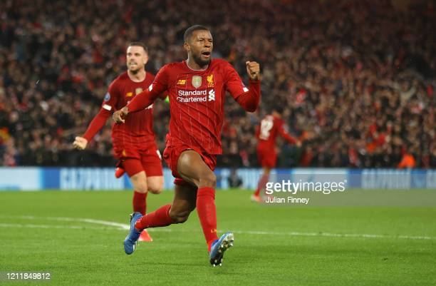 Georginio Wijnaldum of Liverpool celebrates after scoring his team's first goal during the UEFA Champions League round of 16 second leg match between...