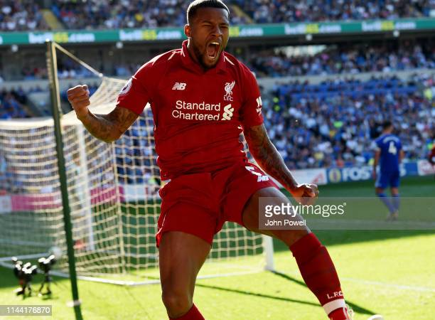 Georginio Wijnaldum of Liverpool celebrates after scoring the opening goal during the Premier League match between Cardiff City and Liverpool FC at...