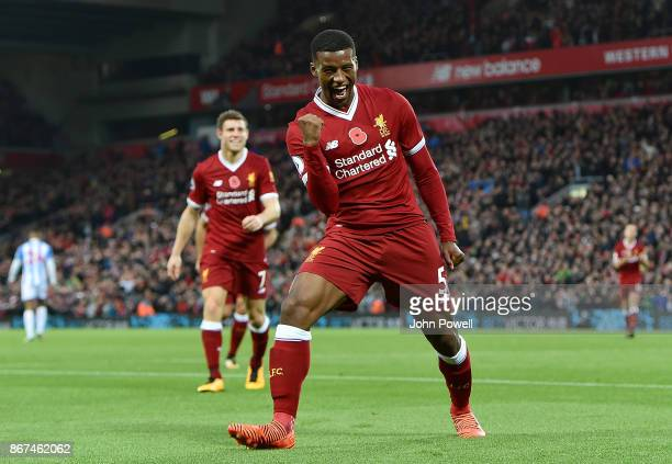 Georginio Wijnaldum of Liverpool celebrates after scoring the third goal during the Premier League match between Liverpool and Huddersfield Town at...