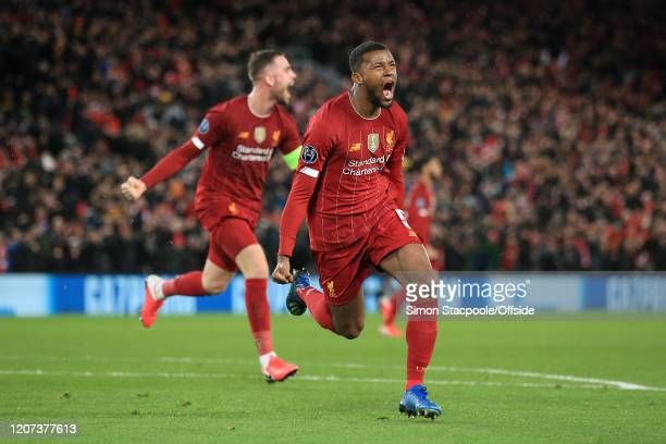Georginio Wijnaldum of Liverpool celebrates after scoring their 1st goal during the UEFA Champions League round of 16 second leg match between...