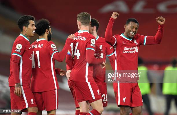 Georginio Wijnaldum of Liverpool celebrates after scoring their sides second goal during the Premier League match between Liverpool and Wolverhampton...