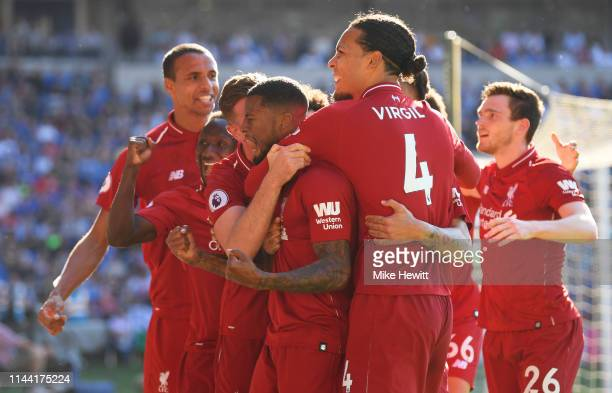 Georginio Wijnaldum of Liverpool celebrates as he scores his team's first goal with Virgil van Dijk and team mates during the Premier League match...