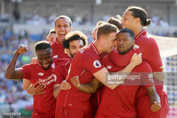 Georginio Wijnaldum of Liverpool celebrates as he scores his team's first goal with Jordan Henderson and team mates during the Premier League match...