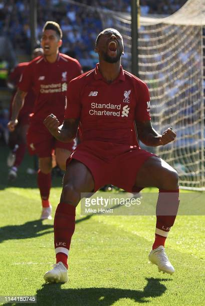 Georginio Wijnaldum of Liverpool celebrates as he scores his team's first goal during the Premier League match between Cardiff City and Liverpool FC...