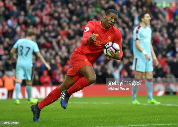 Georginio Wijnaldum of Liverpool celebrates as he scores their first and equalising goal during the Premier League match between Liverpool and...