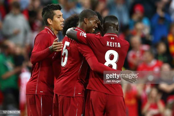 Georginio Wijnaldum of Liverpool celebrates his goal with team mates during the preseason friendly match between Liverpool and Torino at Anfield on...