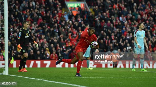 Georginio Wijnaldum of Liverpool Celebrates Liverpools Equiliser during the Premier League match between Liverpool and Burnley at Anfield on March 12...