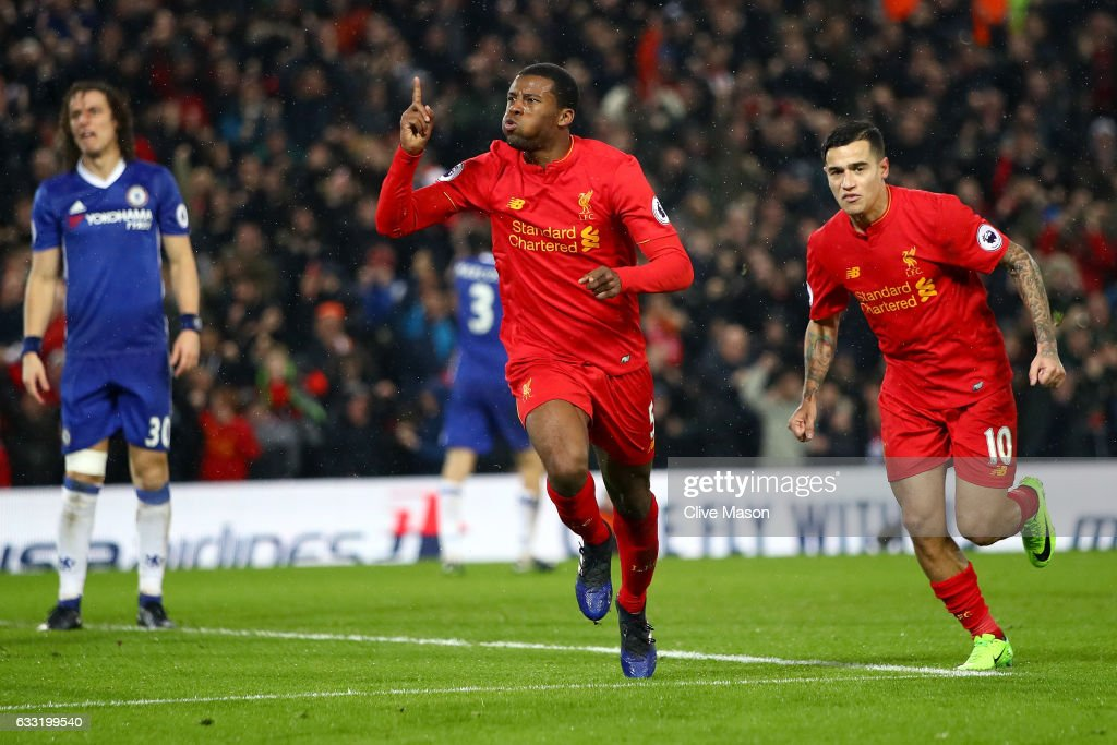 Georginio Wijnaldum of Liverpool celebrates scoring his side's first goal to make it 1-1 during the Premier League match between Liverpool and Chelsea at Anfield on January 31, 2017 in Liverpool, England.