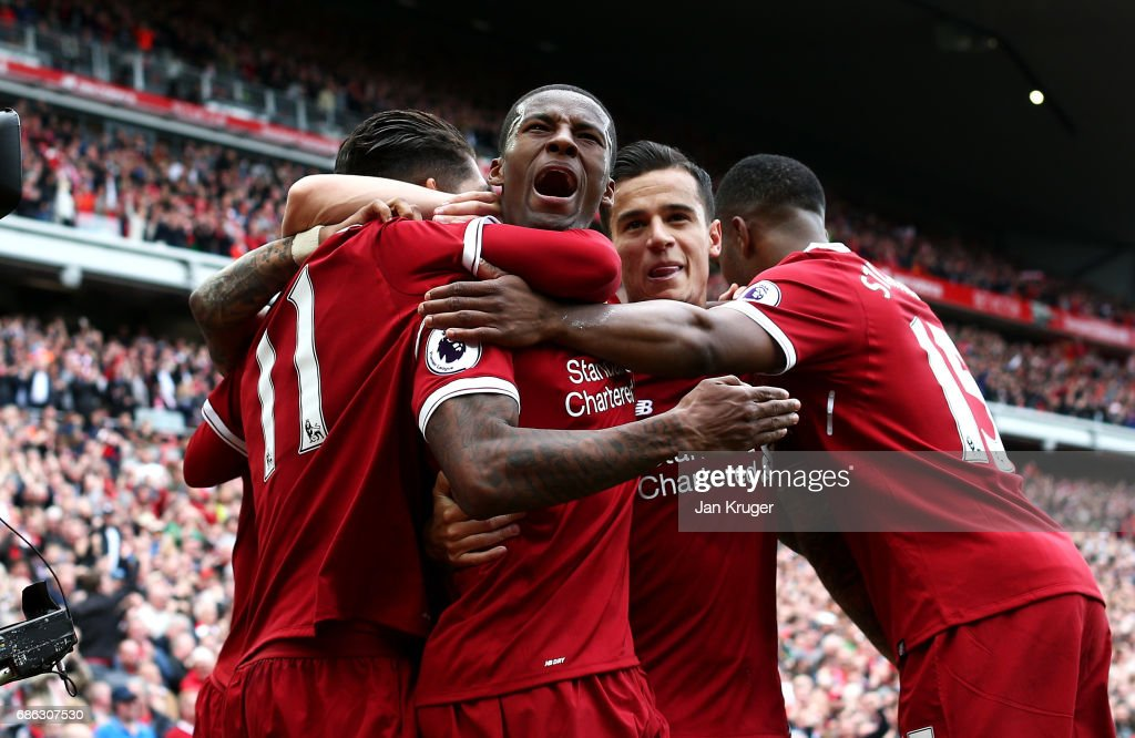 Georginio Wijnaldum of Liverpool celebrates scoring his sides first goal during the Premier League match between Liverpool and Middlesbrough at Anfield on May 21, 2017 in Liverpool, England.