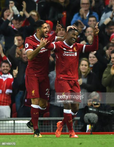 Georginio Wijnaldum of Liverpool celebrates scoring his sides third goal with Emre Can of Liverpool during the Premier League match between Liverpool...