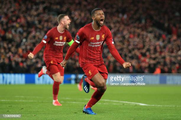 Georginio Wijnaldum of Liverpool celebrates scoring the opening goal during the UEFA Champions League round of 16 second leg match between Liverpool...