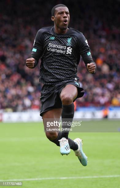 Georginio Wijnaldum of Liverpool celebrates scoring the winning goal during the Premier League match between Sheffield United and Liverpool FC at...