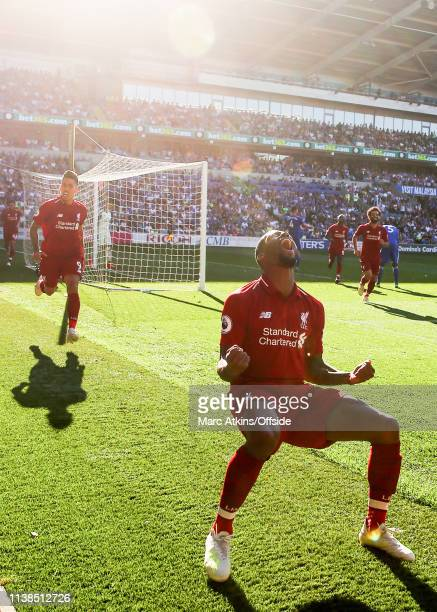 Georginio Wijnaldum of Liverpool celebrates scoring their 1st goal during the Premier League match between Cardiff City and Liverpool FC at Cardiff...